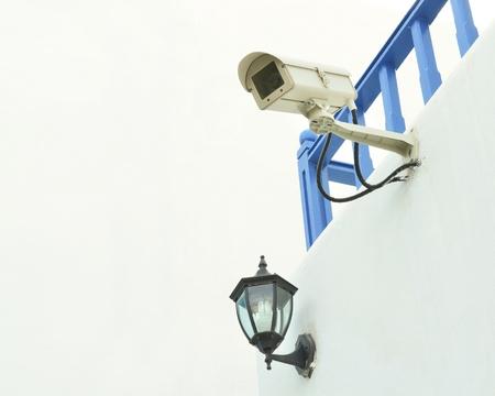 Surveillance camera on the wall Stock Photo - 15099141