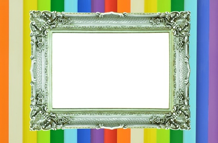 Vintage silver picture frame on rainbow colorful wall photo