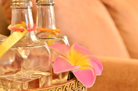 Essence of flower - glass bottle with pink flower - spa, wellness or homeopathy background with space for your text photo
