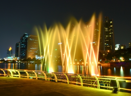 Colorful Fountain of water shooting up photo
