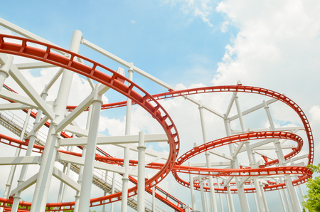 theme park: Colorful roller coaster over blue sky Stock Photo