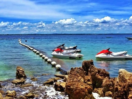 personal watercraft: Parked Jet Skis near the beach
