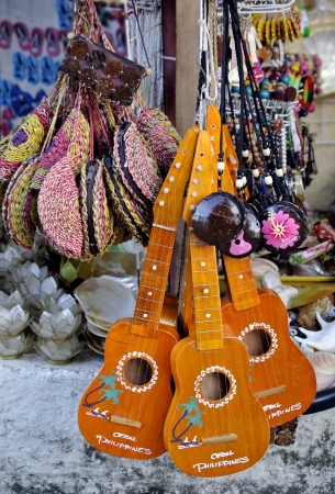 trinkets: Ukelele and souvenirs for sale