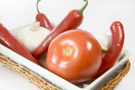 tomatos: isolated tomatos and paprika,garlic Stock Photo
