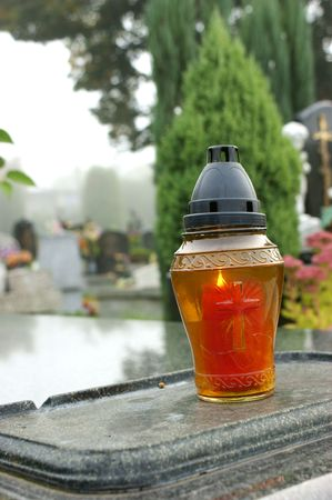 Cementery candle on grave in All Souls' Day Stock Photo - 5546240