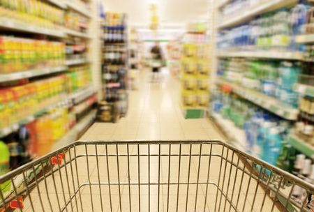 product purchase: Shopping in supermarket Stock Photo