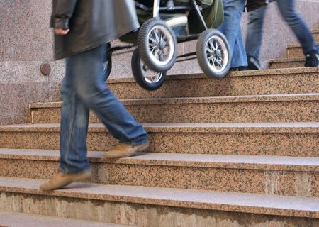 endure: Man and woman endure pram after stairs Stock Photo