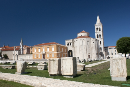 Old column, church and cathedral tower in Zadar on Croatia photo