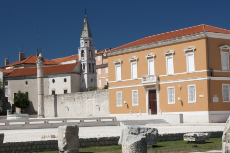 Ruins, and orange buildings in Zadar city on Croatia photo