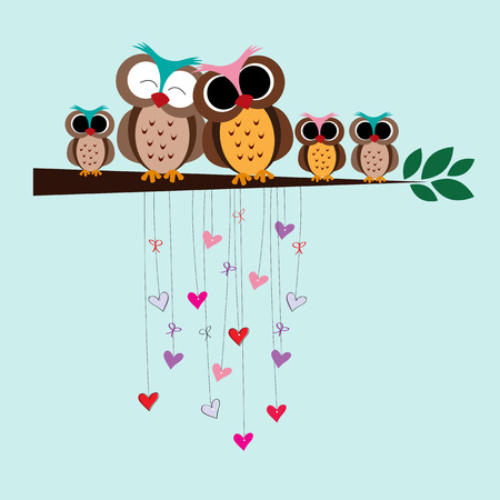 lovely couple: Cute and happy family of owls on a branch