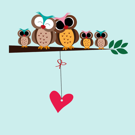 lovely couple: Cute and happy family of owls on the branch