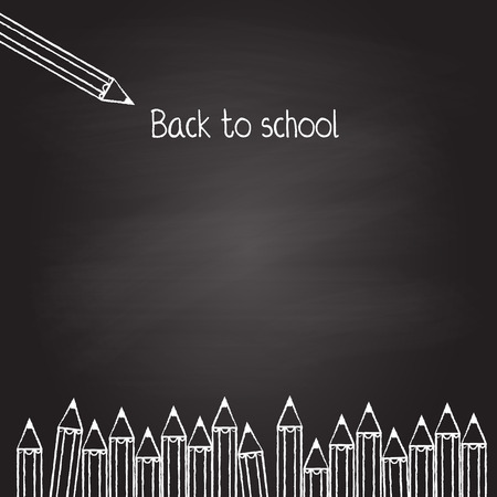 Black board with white chalked crayons