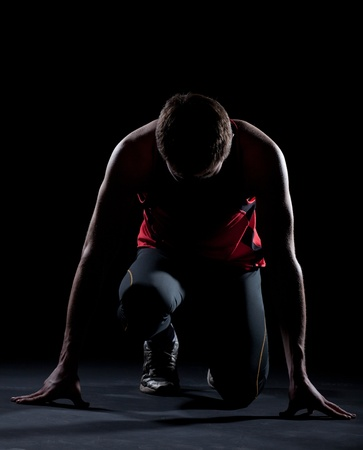 Athlete ready to start on black background Stock Photo - 9028611