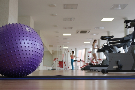 Ball and treadmills in the health club photo
