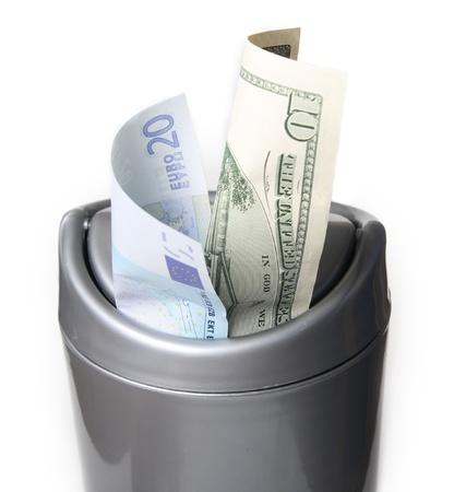 needless: Money in trash bin, isolated