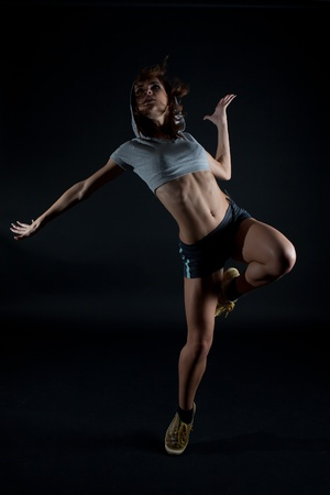 Modern dancer poses on black background Stock Photo - 9360332