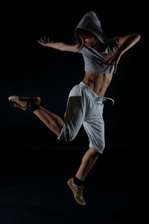 Modern dancer poses on black background