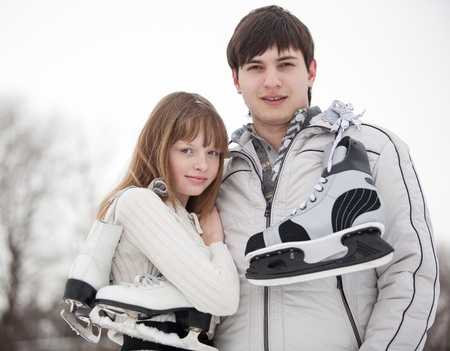 Portrait of a young couple with skates photo