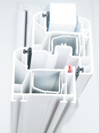 Cut of White PVC Window Profile 免版税图像