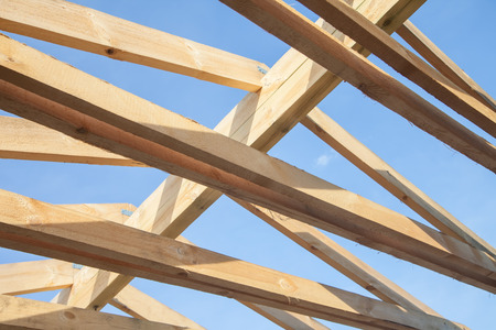 rafter: Wooden roof with rafter style framing against a blue sky Stock Photo