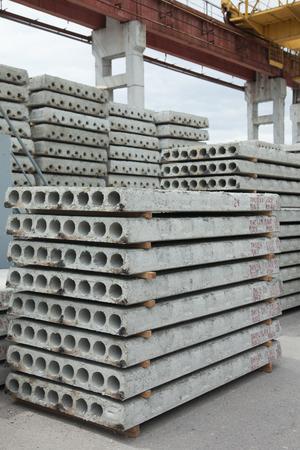 Stacks of precast reinforced floor slabs