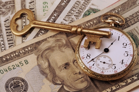 Conceptual keys to success of time and money. Rich colors and clear shot with skeleton key, US currrency, an old watch that portrays spending, finance, business success. Has been used on several high profile web sites.