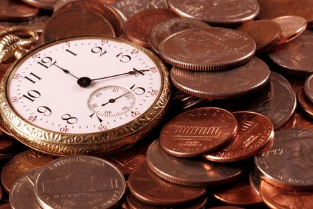Time And Money Concept - Old pocketwatch and US Coins