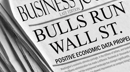 Bulls Run Wall St. - positive economic news in a newspaper with bull market headlines.