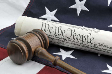American Justice - Constitution, Wooden Gavel, and US Flag photo