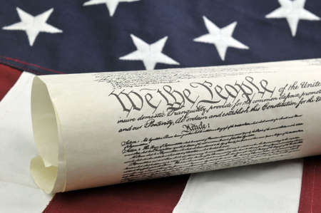 governmental: We The People - US Constitution and American Flag Stock Photo