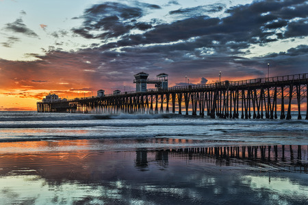 california beach: Oceanside Pier at sunset  Oceanside is 40 miles North of San Diego, California  Stock Photo