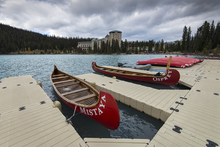 Several rental canoes on the last day of the season at Lake Louise, Banff National Park, Alberta, Canada.