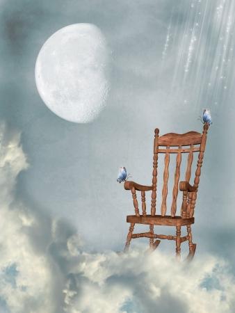 silla de madera: mecedora en el cielo con las mariposas y la luna