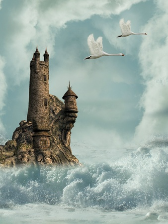 fairytale castle: castle in the ocean with swans and waves Stock Photo