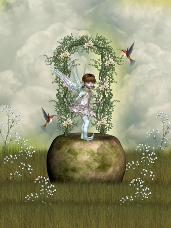 fairytale scene with flowers stone and hummingbird photo