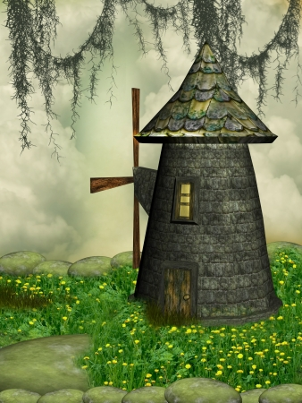 fantasy Windmill in the garden with flowers photo