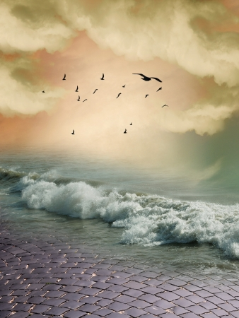 fantasy landscape with birds rocks and ocean photo