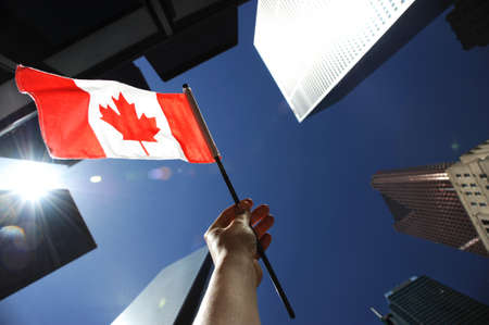 Canadian Flag against Toronto Financial District Buildings