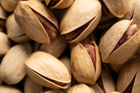 Macro image of salty pistachios in nut shell, pistachios top view in high resolution