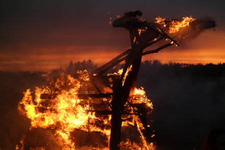 burns night: Wooden structure burns with sparks at night. Stock Photo
