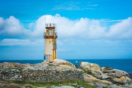 Lighthouse of Muxia facing North Atlantic Ocean, Spain. Stockfoto - 131855256