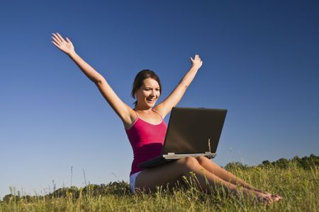 Beautiful young woman using a laptop, and happy. Stock Photo - 5213656