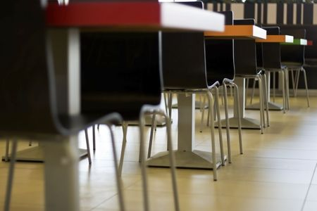 chairs and tables line the restaurant. Stock Photo - 5243049
