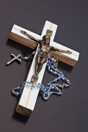 Jesus and rosary unlit background isolate. photo