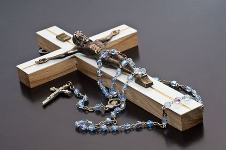 in good spirits: Jesus and rosary white background isolate. Stock Photo