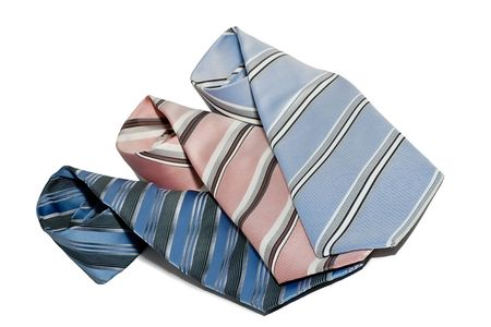 rolled up: Tie rolled up three, white background isolate. Stock Photo