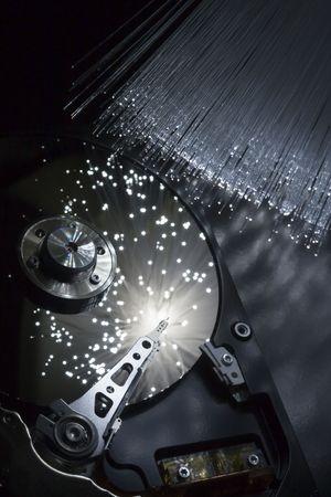 Computers hard drive optical fiber floodlight. photo