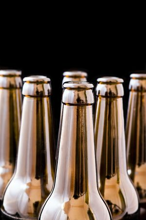 An open beer bottle, black background isolated. photo