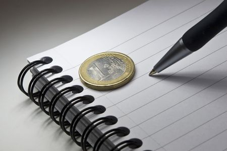 Writing pad, pen and one Euro. photo