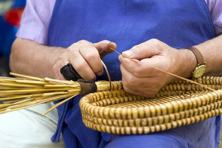 Craft man, spin basket. Stock Photo - 5340827